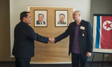 Ulrich Larsen shaking hands at KFA meeting in Köln, Germany.