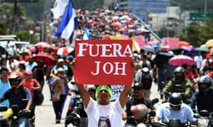 Hundreds of people of people take part in a protest in Tegucigalpa demanding the resignation of the Honduran president, Juan Orlando Hernández, for his alleged links with drug trafficking.