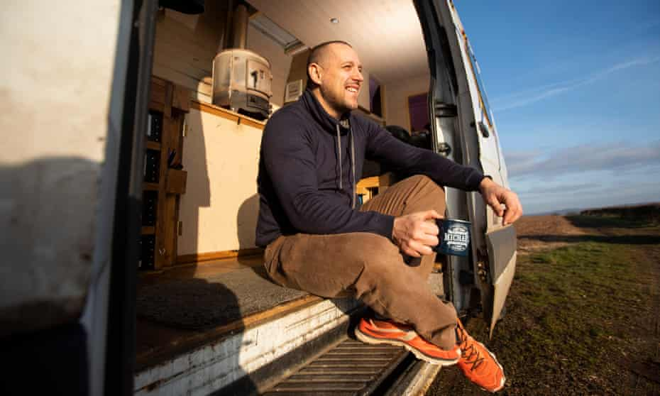Michael Hayne in the van he has converted into a home.