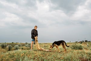 Vadim plays a game with his German shepherd and a sheepskin. Much of Gagauzia looks like Europe did before urbanisation, with the people living similar lives to those of their grandparents