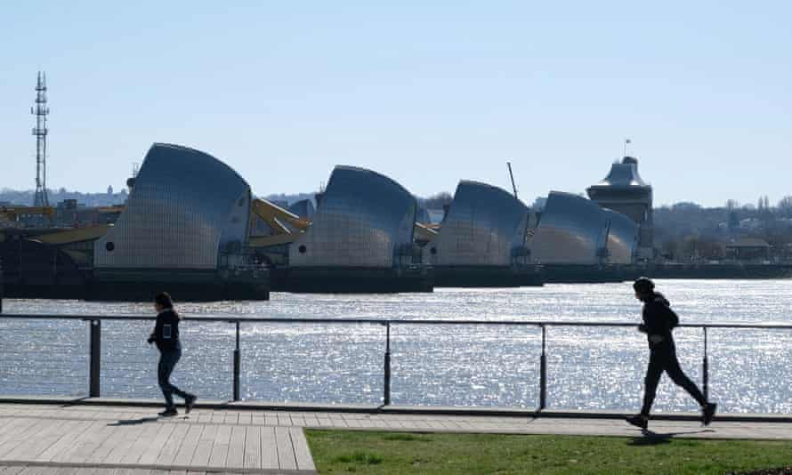Joggers in Thames Barrier Park in Silvertown