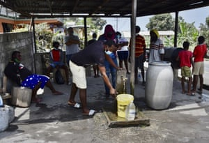 People collect uncontaminated water.