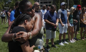 Mourners gather at a vigil following a mass shooting in Dayton, Ohio.