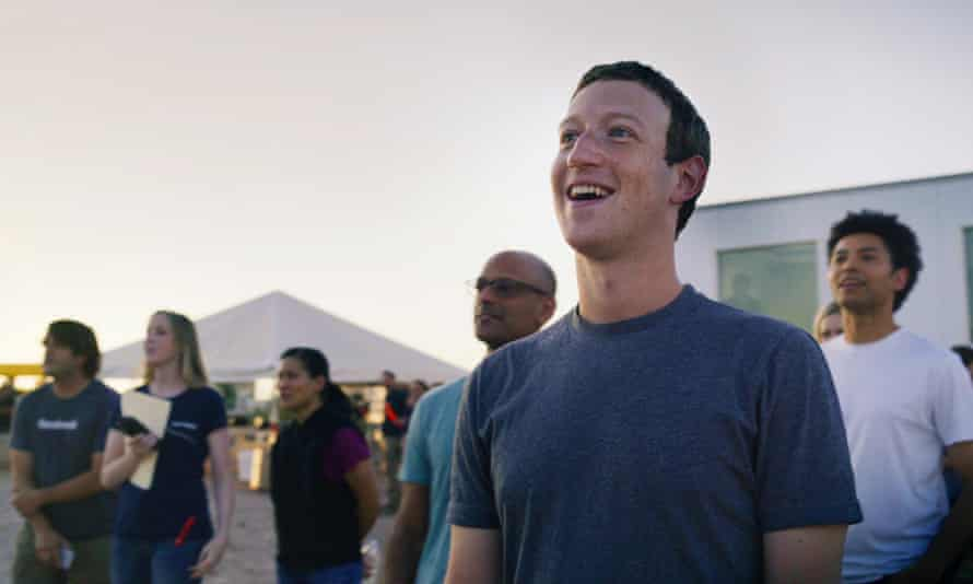 Facebook founder Mark Zuckerberg and his team watch the drone take flight.