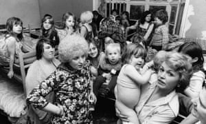 Victims of domestic violence in crowded living conditions at a women's refuge in Chiswick, London, in 1974.