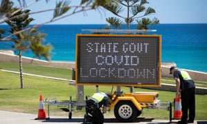 Covid sign being set up on a Perth beach