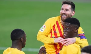 FBL-ESP-LIGA-OSASUNA-BARCELONA<br>Barcelona's Spanish midfielder Ilaix Moriba (R) celebrates with Barcelona's Argentinian forward Lionel Messi and Barcelona's French forward Ousmane Dembele after scoring during the Spanish League football match between CA Osasuna and FC Barcelona at El Sadar stadium in Pamplona on March 6, 2021. (Photo by ANDER GILLENEA / AFP) (Photo by ANDER GILLENEA/AFP via Getty Images)