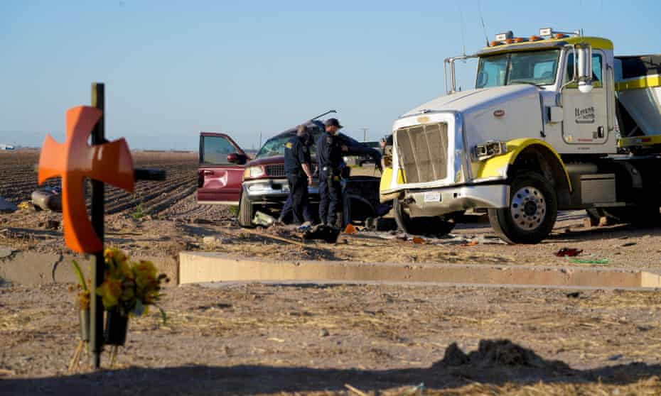 Law enforcement investigators inspect the scene of a deadly crash on State Highway 115 near the US-Mexico border.