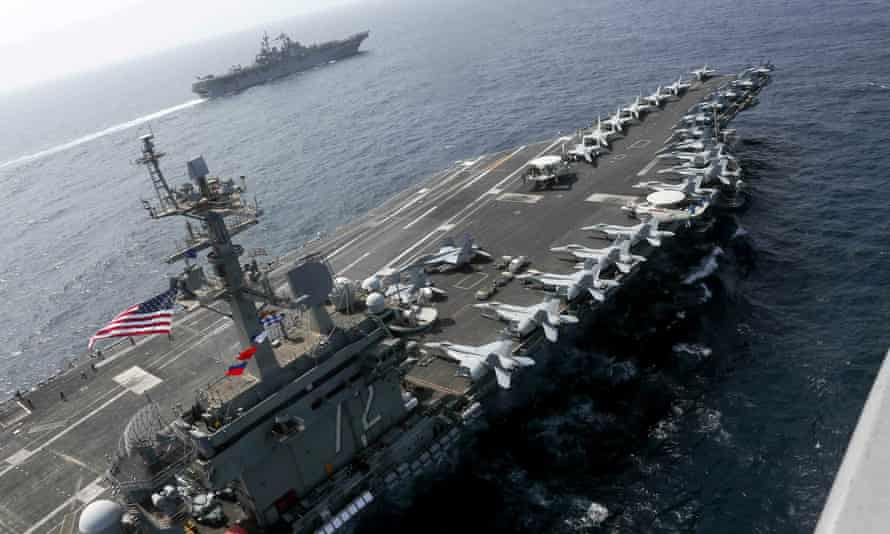 In a picture released on Friday, the USS Abraham Lincoln sails in the Arabian Sea near the amphibious assault ship USS Kearsarge.