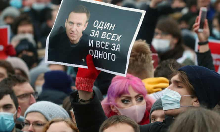 A man holds a portrait of Alexei Navalny at a rally in Moscow.