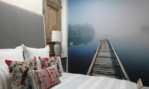 Room with a view: the main bedroom with its restful mural and bed that folds into a meditation platform.