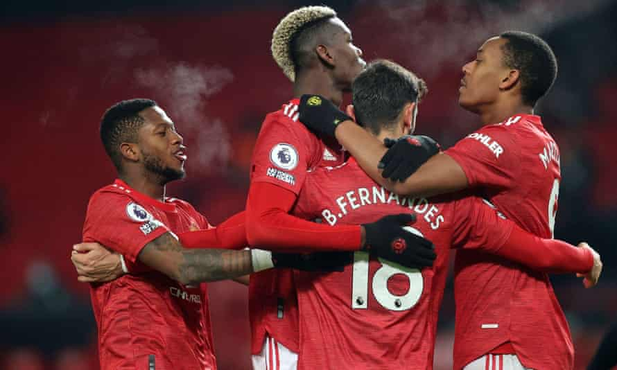 The Manchester United players Fred, Paul Pogba, Bruno Fernandes and Anthony Martial celebrate Fernandes's penalty in the New Year's Day win against Aston Villa.