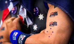 A man shows off Australian flag tattoos during Australia Day celebrations, 2017