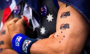 A man shows off Australian flag tattoos during Australia Day celebrations.
