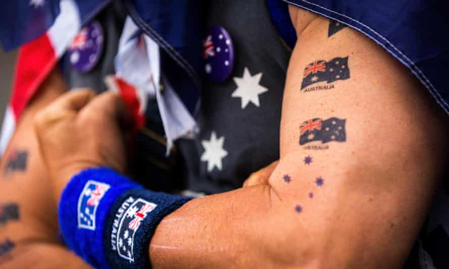 A man shows off Australian flag tattoos during Australia Day celebrations.