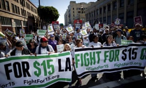 Fast-food workers and their supporters join a nationwide protest for higher wages and union rights in Los Angeles.