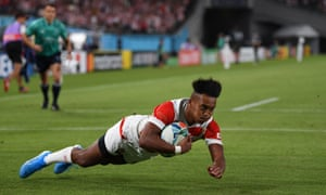 Kotaro Matsushima, with his perfectly swept hair, dives and scores a try during Japan's game against Russia.