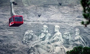 A cable car passes the carvings of Confederate civil war generals as it returns visitors from the top of Stone Mountain in Georgia.