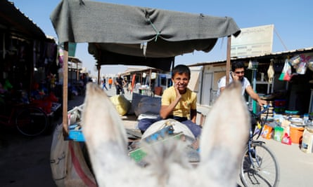 A Syrian boy helping shop owners at the Zaatari refugee camp in Jordan.