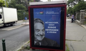 """An anti-Soros campaign ad reading """"99 percent reject illegal migration"""" and """"Let's not allow Soros to have the last laugh"""" in Budapest, Hungary."""