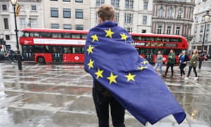 demonstrator wrapped in EU flag leaving an anti-Brexit protest