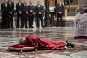 Pope Francis lies on the floor during the Good Friday Passion of the Lord Mass in Saint Peter's Basilica at the Vatican, March 30, 2018. Osservatore Romano/Handout via REUTERS ATTENTION EDITORS - THIS IMAGE WAS PROVIDED BY A THIRD PARTY