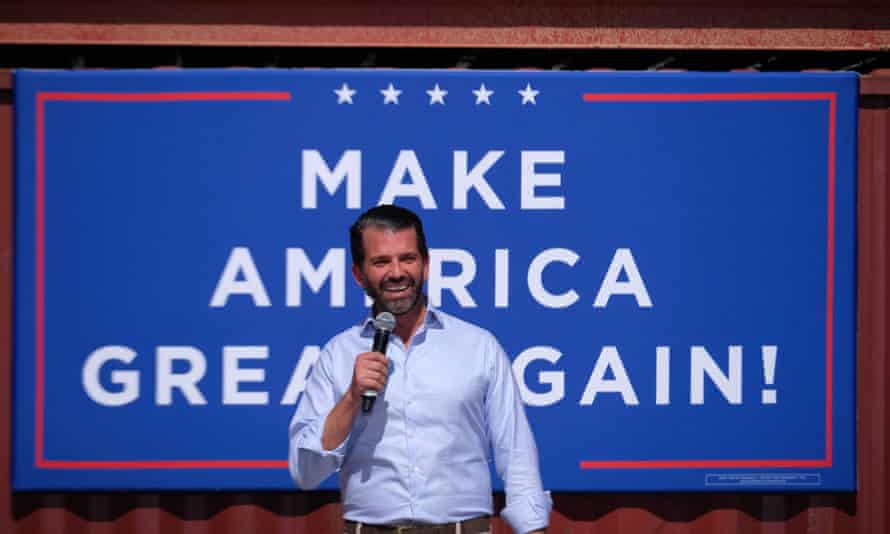 "Donald Trump Jr thanked the maker of the banner but said ""let's get through 2020 with a big win first""."