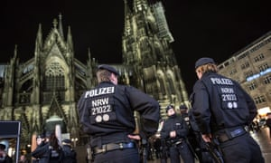 Police forces guard the area around Cologne Cathedral after the New Year's Eve attacks