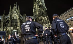 Police at Cologne cathedral and central railway station.