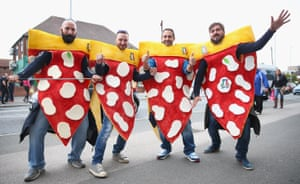 Did any fans sitting near these Italy fans suddenly get an urge for some pizza or has it put them off it?