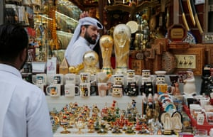 A merchandise stall with replica World Cups in the Souq Waqif market.