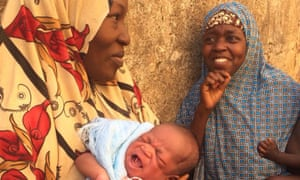Binta Siddique, left, and Hanza Absulane await anti-polio vaccinations for their babies.