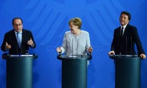 Francois Hollande, Angela Merkel and Matteo Renzi address a press conference in Berlin on Tuesday.