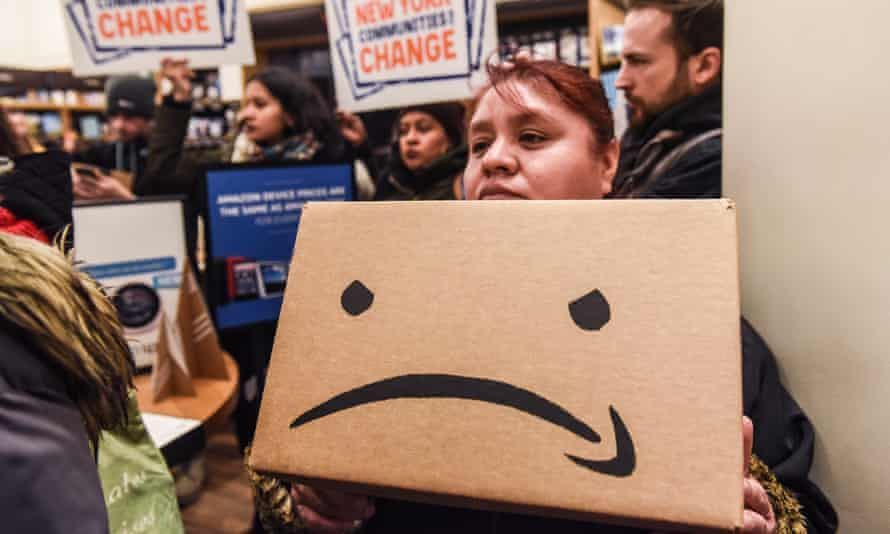 "Protestors In New York City Hold ""Day Of Action"" Against Amazon HQ2<br>NEW YORK, NY - NOVEMBER 26: People opposed to Amazon's plan to locate a headquarters in New York City hold a protest inside of an Amazon book store on 34th. St. on November 26, 2018 in New York City. Amazon recently announced that New York City will become one of two locations that will house Amazon's second North American headquarters, known as HQ2. (Photo by Stephanie Keith/Getty Images)"
