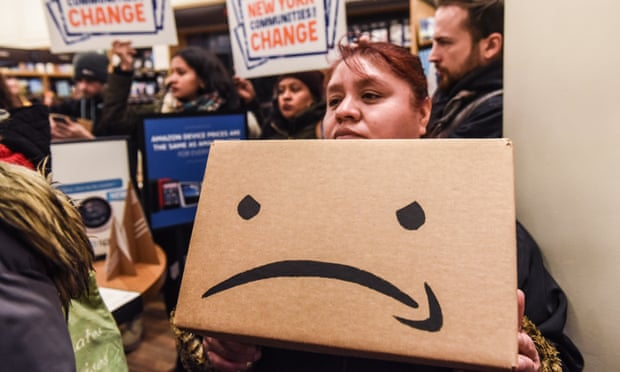 """Protestors In New York City Hold """"Day Of Action"""" Against Amazon HQ2<br>NEW YORK, NY - NOVEMBER 26: People opposed to Amazon's plan to locate a headquarters in New York City hold a protest inside of an Amazon book store on 34th. St. on November 26, 2018 in New York City. Amazon recently announced that New York City will become one of two locations that will house Amazon's second North American headquarters, known as HQ2. (Photo by Stephanie Keith/Getty Images)"""