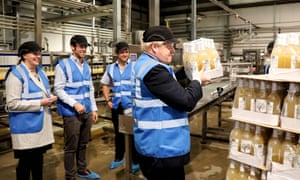 Boris Johnson carrying a dozen bottles of cider on a visit to Healey's Cornish Cyder Farm in Callestick, Cornwall.