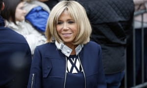 French first lady-elect in a sleek Louis Vuitton navy coat.