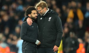Mohamed Salah of Liverpool is congratulated by his manager Jurgen Klopp after the final whistle.