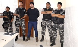 Brazilian military police stand with who they identify as Jose Irandir Cardoso – the man convicted in the killing of yachtsman Sir Peter Blake. Lieutenant Felipe Lopes is second right.