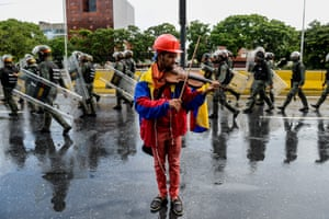 An opposition demonstrator plays the violin during a protest against President Nicolas Maduro in Caracas, Venezuela