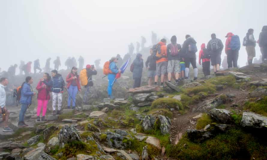 People queuing to reach the summit of Snowdon last week.