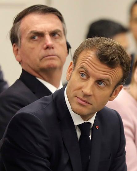 Emmanuel Macron sits with Jair Bolsonaro (back L) at the G20 Summit in Osaka in 2019.