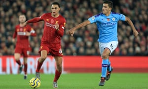 Rodri (right) tries to keep up with Liverpool's Trent Alexander-Arnold during Manchester City's 3-1 defeat at Anfield.