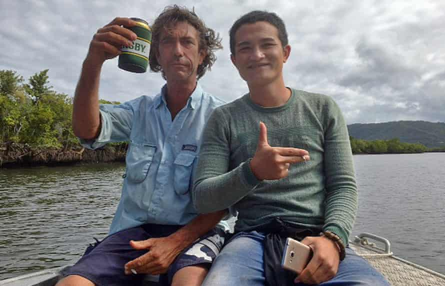 Justin Ward gives a suspected asylum seeker a tour before handing him in to authorities.