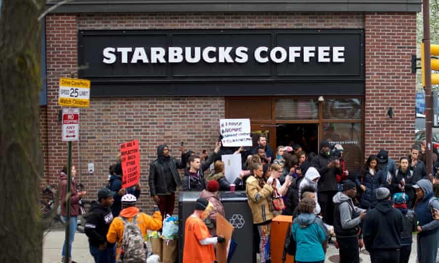 Philadelphia Police Arrest Of Two Black Men In Starbucks, Prompts Apology From Company's CEO<br>PHILADELPHIA, PA - APRIL 15: Protestors demonstrate outside a Center City Starbucks on April 15, 2018 in Philadelphia, Pennsylvania. Police arrested two black men who were waiting inside the Center City Starbucks which prompted an apology from the company's CEO. (Photo by Mark Makela/Getty Images)