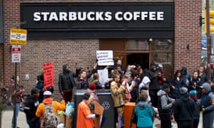 Protestors demonstrate outside a Starbucks on Sunday in Philadelphia, Pennsylvania, after police arrested two black men who were waiting inside the Starbucks.