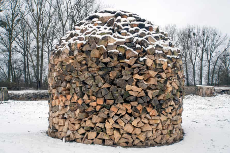 A neatly arranged pile of logs sits near the Pripyat River. Approximately 40% of Belarus, or about 8m hectares, is forested.