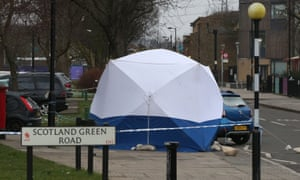 Police at scene of a murder in Enfield
