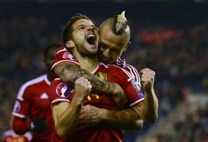 Belgium's forward Dries Mertens celebrates with Radja Nainggolan.