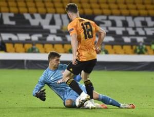 Olympiakos' goalkeeper Bobby Allain, left, stops a shot from Wolverhampton Wanderers' Diogo Jota.